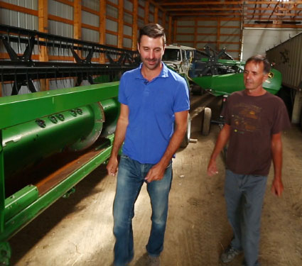 Two men in a machine shed