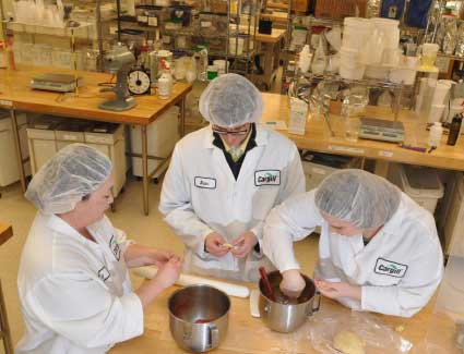 Three people working in a test kitchen