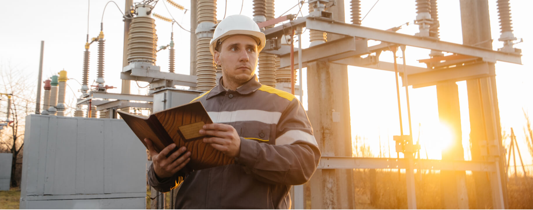 Man-standing-in-front-of-transformer-substation